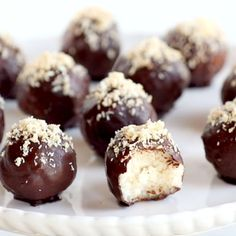 These dark chocolate coconut bites are naturally sweet and creamy on the inside and covered with a layer of delicious chocolate dessert snackrecipes chocolate naturallysweet veganrecipe Healthy Desserts, Just Desserts, Delicious Desserts, Yummy Food, Coconut Desserts, Desserts Menu, Sweet Recipes, Cake Recipes, Snack Recipes