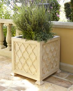 Outdoor Quatrefoil Planter - A lovely quatrefoil pattern dresses up this neutral planter, making it an elegant showcase for florals and greenery.