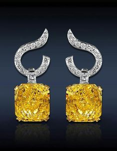 Jacob & Co. Fancy Yellow Diamond Drop Earrings, Featuring: Ct Fancy Vivid Yellow Radiant Cut Diamonds Stones), Highlighted with Pave Set White Diamonds on a Swirl Bail Set in Rose and White Gold. Gems Jewelry, High Jewelry, Gemstone Jewelry, Diamond Jewelry, Jewelry Box, Jewelry Accessories, Jewelry Design, Pandora Jewelry, Diamond Drop Earrings
