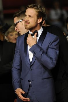 I don't know many guys who can pull off a blue suit and faces like that, but guess who can?!
