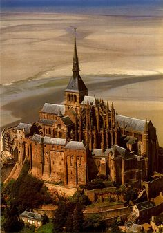 """Mont Saint-Michel, France, at low tide - I now have Look Down/Paris from Les Mis playing in my head. """"This is my school, my high society here in the slums of Saint Michel! Places Around The World, Oh The Places You'll Go, Places To Travel, Places To Visit, Around The Worlds, Mont Saint Michel France, Beautiful Castles, Beautiful Buildings, Wonderful Places"""