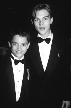 Elijah Wood and Leonardo DiCaprio hanging out at the Oscars... 20 years ago