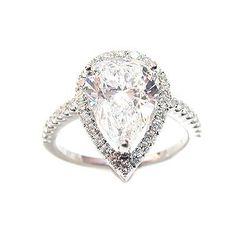 I love this teardrop engagement ring... wedding-rings-rings-rings