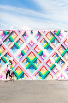 Wynwood Walls in Miami, MUST visit. The walls are painted in very bright colors with artistic patterns and illustrations.