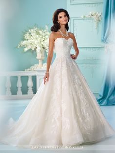 Strapless A-line wedding dress features layers of tulle, organza and allover embroidered lace, sweetheart neckline