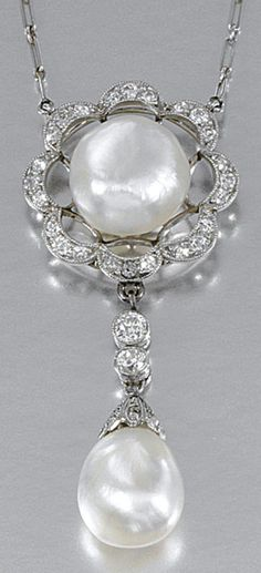 PEARL AND DIAMOND PENDANT, CIRCA 1910.  The surmount of open work design millegrain-set with circular- and single-cut diamonds centring on a bouton pearl, suspending a capped drop-shaped pearl between a similarly set connection to a fine curb and fetter link chain, length approximately 425mm to 470mm with extension, numbered.