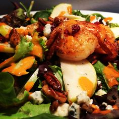 Salad; grilled shrimp, gorgonzola, candy pecan, cranberry, sliced green apple, in a roasted pepper vinaigrette over a spring mix. #northportny #northport  #ninaspizzeria