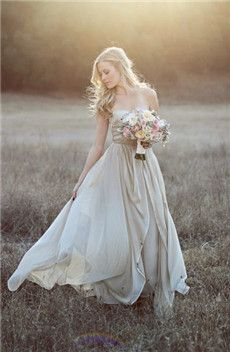 vintage wedding dress in a beautiful outdoor setting.