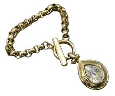 Show off your taste for designer jewelry with this handsome Givenchy charm bracelet. A massive golden tear drop sparkles with a rhinestone center dangling from a box link chain and toggle closure. #stuff4uand4u