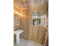 Bamboo wall bathroom - cabana bath - tropical - coastal.  Port Royal in Naples, FL