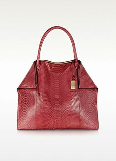 Ghibli Large Coral Python Leather Tote. Large coral tone python leather tote with double handles and gold tone zip closure. Featuring fold-over top corners with magnetic hold and detachable signature gold tone hang tag. Interior is lined in signature fabric and has one zip and one cell phone pocket. Made in Italy. http://www.eu.forzieri.com/handbags/ghibli/gh131113-011-00
