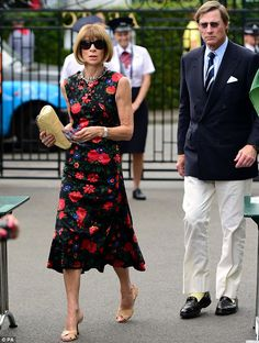 Slim and sleak: In a calf length red and black floral dress, tan heels and matching clutch...