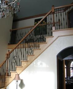 Sectional Stair with Scroll Pattern Spindles & Custom Newels   Flared Stairs from Great Lakes Stair and Millwork. See custom staircase ideas at Stair.com.