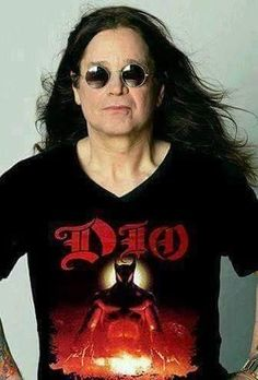 Not sure if this is a real image, but Ozzy Osbourne celebrating Ronnie James Dio would be appropriate. The Godfathers of Heavy metal