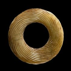 China, Bi Disc-Ring with Wound Rope Pattern, Spring and Autumn-Warring States Period, 770 - 221 BCE. Jade