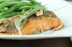 Add a little flavorful touch with rosemary and pecans to your Paleo baked salmon recipe.