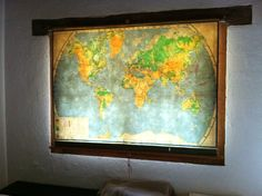 Fabulous window covering. An old school, pull down map.