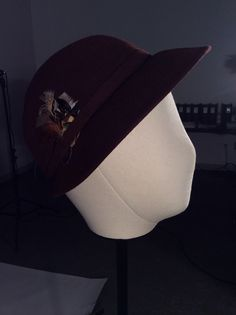 1950s brown felted hat with tiny feather