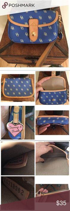 """DOONEY & BOURKE WRISTLET Excellent condition.  Clean interior and exterior.    No rips, stains or tears.  Very minimal wear to the leather.  This will hold an IPhone but not the IPhone plus.  MEASUREMENTS ARE APPROXIMATE:  6.0"""" L X  4.0"""" H X 1.25"""" D. TRADESLOWBALL Dooney & Bourke Bags Clutches & Wristlets"""