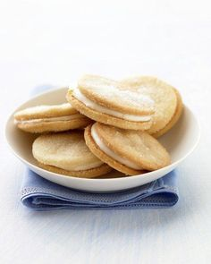 These lemon sandwich cookies are unique, sophisticated, delicious, and very easy to make. Bless you Martha Stewart! Lemon Desserts, Lemon Recipes, Cookie Desserts, Just Desserts, Cookie Recipes, Dessert Recipes, Bakery Recipes, Easter Recipes, Dessert Ideas