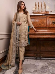 Subtle beige embroidery straight cut suit online which is crafted from chiffon fabric with exclusive embroidery. This stunning designer straight cut suit comes with raw silk bottom and chiffon dupatta. Women's A Line Dresses, Salwar Suits Online, Straight Cut, Chiffon Fabric, Duster Coat, Beige, Embroidery, Silk, Jackets