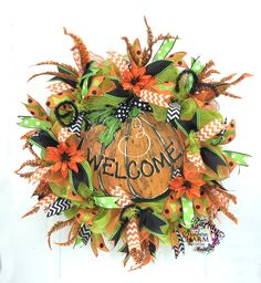 Deco Mesh Halloween Welcome Wreath with faux pumpkin chalkboard welcome sign by www.southerncharmwreaths.com