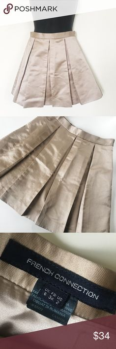 French Connection Pleated High Waist Mini Skirt •Pleated Style •Can be worn high waisted. •Hidden Zipper & Hook Closure •Lined Size: 2 Color: Gold / Beige Condition: Excellent Used Condition   - Minor hanger marks from storage. Material: 67% Cotton 33% Polyester.  Lining: 100% Acetate  Measurements: Length: 16 Waist: 26 All measurements are approximate.  No stains, rips, tears. Pet/Smoke free home. Offers welcomed. French Connection Skirts Mini