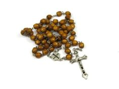 Lady of Guadalupe Full Length Brown Wood Bead Rosary Necklace Creative Ventures Jewelry. $8.99. Rosary made from brown wood beads. Use for prayer, hang on wall, or wear as necklace. Full length traditional Catholic rosary / necklace. Rosary comes in case as shown in picture