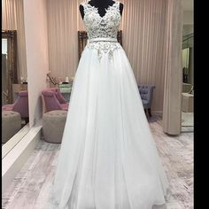 This sleeveless bridal gown has a beautiful lace bodice. We can make elegant #weddingdresses like this at an affordable cost. We are near Dallas Texas but sell custom designs to brides all over. We can also make #replicaweddingdresses that are less expensive but still look like the original. Pricing available at www.dariuscordell.com