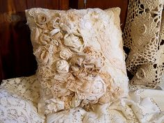 Amazing use of old lace......Beautiful Victorian Vintage Ring Bearer Pillow or Throw Pillow, handmade of vintage fabrics and lace. FREE Shipping. $29.95, via Etsy.
