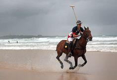 Polo player Major Ben Marshall on Burris practises on the beach ahead of tomorrow's beach polo event in Newquay, England. Several thousand people are expected to watch the Veuve Cliquot sponsored event, now in its sixth year, is being played tomorrow on one of the Cornwall's most popular surfing beaches.