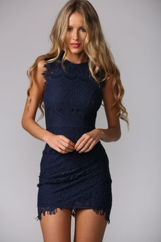 Sleeveless navy dress. Crotchet detailing.  High neckline. Invisible back zip. Bodycon fit. Inner lining. Cotton/polyester. Please choose sizes carefully because this dress runs small in size.