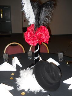 decoratio pictures of a 1920's wedding in the colors of black and white | ... black vase with roses and pearls. Then we added lights and feathers