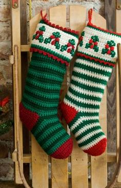 Holly and Berry Stockings on Red Heart - part of a great roundup of free stocking patterns on mooglyblog.com