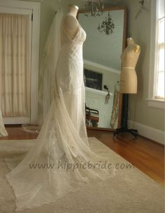 A light and ethereal wedding gown made from antique lace with an art deco pattern and sequined organza, Pearl and loop back closure. Low back and a bias cut sexy silk slip. Inspired by 1930's evening gown designs. Handmade and one of a kind by Hippie Bride. www.hippiebride.com