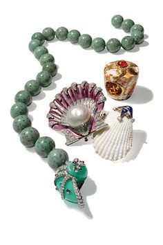 Shell Shock , the WSJ: From left clockwise, Tiffany & Co., John Hardy Cinta, Cartier, Verdura. #Jewelry #Shells