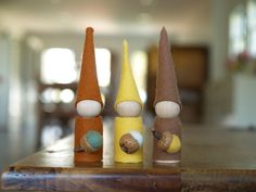 Tutorial for Autumn Gnome felt peg dolls dressed in our Holland Wool Felt. Wood peg dolls, real acorn caps and felted balls also at A Child's Dream.