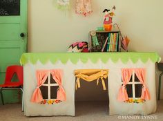 so cute! it's like a tablecloth/clubhouse. I had one of these when I was a kid. But mine fit over a card table!! AW!!!