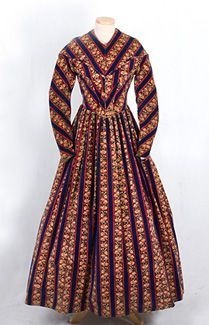 Printed cotton velveteen day dress, 1850s. Over the years, I have found few printed velveteens from this period. The brilliant fabric still radiates a memorable richness of color. A very old, minor alteration does not compromise the original style. Maintenance of design integrity and the rare fabric