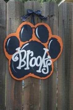"""There are so many choices for door hangers and outdoor team spirit signs, but these by Dondee Hicks at Artist Tree are so charming. """"Each door hanger is cut from premium quality wood, sande… Painted Doors, Wooden Doors, Painted Letters, Painted Signs, Cnc, Cheer Camp, Tiger Paw, Locker Decorations, Burlap Door Hangers"""