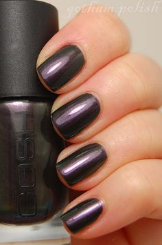 Dark purple nail polish....my current girly obsession! Not quite emo, not quite girly....but very very flirty! Loving the Rimmel brand!