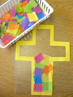 Stained Glass Easter Cross Craft. Use construction paper, colorful tissue paper, file folders and sticky contact paper to create an Easter cross for kids. Teach them the true meaning of Easter. http://hative.com/cute-easter-craft-ideas-for-kids/