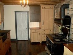 ... kitchen with handcrafted cabinets to imulate the era of an early 1800