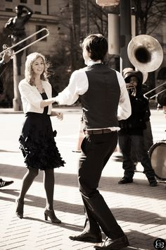 Newly engaged couple dancing to the beat of the Street Corner Band - Seen at Trade & Tryon
