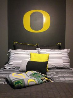 Alex really wants a Ducks themed room but shares with his brother -- loving the gray walls/bedding for a neutral thee that the Ducks stuff (and his brother's much different style) can pop off of