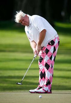 John Daly takes a putt wearing Pink & Black during the Sony Open in Honolulu, Hawaii Source: Golf.com, January 2014 Pga Tour Players, John Daly, Carolina Hurricanes, Golf Tips For Beginners, Honolulu Hawaii, Putt Putt, Ladies Golf, Pink Black, Fun Things