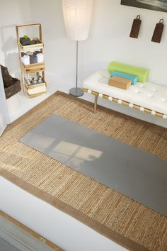 A sleek bench, large-scale artwork, and a natural fiber mat offer a calming space to achieve maximum focus.