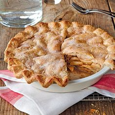 Blue-Ribbon Apple Pie | MyRecipes.com ~ This recipe was inspired by the version that won Pam Brunet a blue ribbon at the LaFayette Apple Festival in New York. She layers a flour-and-cinnamon-sugar mixture with apples to create a dense, rich layer of fruit. Pam credits this recipe to her mother-in-law, Grandma Brunet.