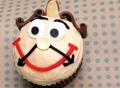 I love these!! Cogsworth from Beauty and the Beast in cupcake form? Yes, please!