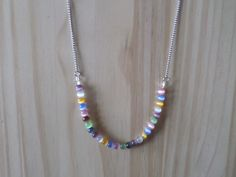 Necklace with multicoloured 4mm glass beads on half chain the chain is stainless steel as is the lobster clasp fastener the beads are on wire with guardians at the ends for added protection against wear and tear. | Shop this product here: http://spreesy.com/Charmmagpie/1 | Shop all of our products at http://spreesy.com/Charmmagpie    | Pinterest selling powered by Spreesy.com